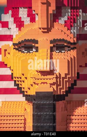 Egyptian pharaoh statue constructed using lego blocks - Stock Image