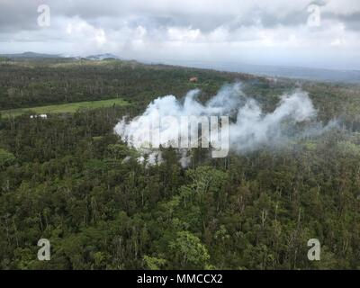 Leilani Estates, Hawaii. May 9, 2018. Aerial view of lava and steam spewing from fissures caused by the Kilauea volcano eruption May 9, 2018 in Leilani Estates, Hawaii. The recent eruption continues destroying homes, forcing evacuations and spewing lava and poison gas on the Big Island of Hawaii. Credit: Planetpix/Alamy Live News - Stock Image