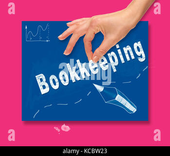 A hand picking up a Bookkeeping concept on a colorful drawing board. - Stock Image