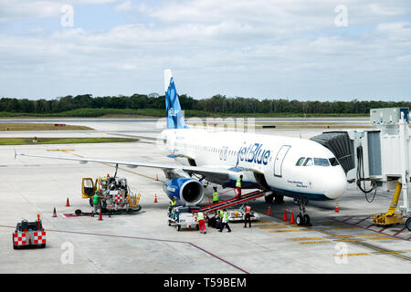 A JetBlue plane on the ground at Cancun Airport, Mexico - Stock Image