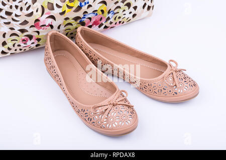 Pair of fashionable female shoes on white background. - Stock Image