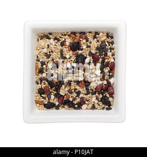 Mixed grains in a square bowl isolated on white background - Stock Image