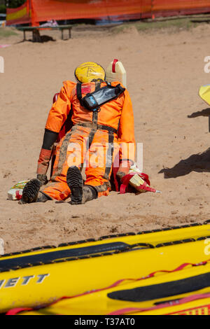 Manikin dummy being used by volunteer surf rescue personnel for training purposes,Palm beach,Sydney,Australia - Stock Image