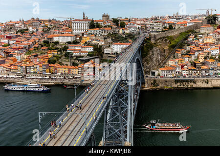 The Dom Luis I Bridge, a double-deck metal arch bridge, constructed in 1886, spans the River Douro between the cities - Stock Image