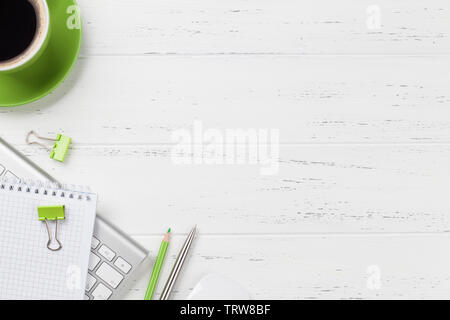 Office workplace table with coffee cup, supplies and computer. Flat lay. Top view with space for your goals - Stock Image