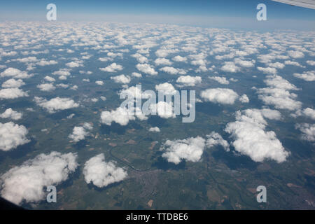 Scatterred cumulus clouds making an attractive pattern - Stock Image