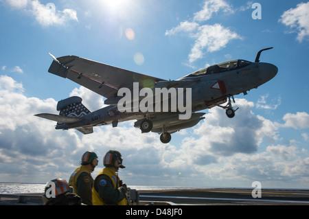 AN EA-6B lands approaches USS Dwight D. Eisenhower. - Stock Image