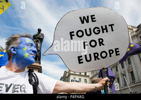 London, UK. 23 June 2018. Man with a painted face like the EU flag. Remain supporters and protesters gather in Pall Mall for an Anti-Brexit March and Rally. Photo: Bettina Strenske/Alamy Live News - Stock Image