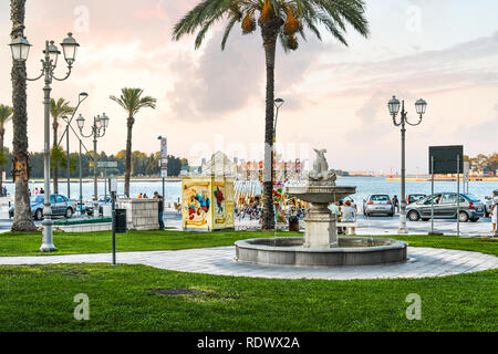 Morning at a small amusement park at the Piazza Vittorio Emanuele II along the coast of the Adriatic Sea in Brindisi, Italy - Stock Image