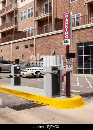 Automated parking lot ticket stand and gate for automobile or car parking only in downtown Montgomery Alabama, USA. - Stock Image