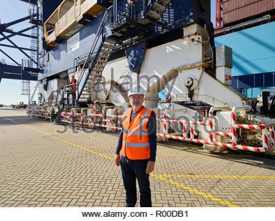 Dock worker in reflective vest at Port of Felixstowe, England - Stock Image