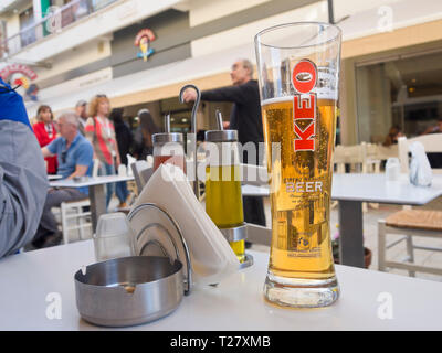 Enjoying a local KEO beer in the Ledras pedestrian street in the Cypriot capital Nicosia - Stock Image