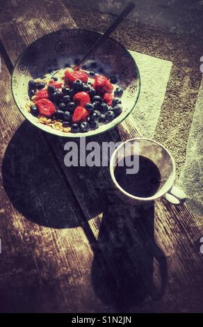 Breakfast; serial, beries and coffee. - Stock Image