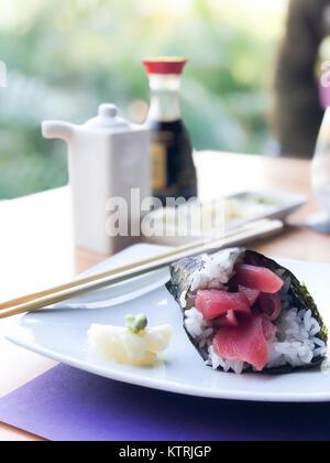 Tuna sushi handroll with sliced ginger and wasabi - Stock Image