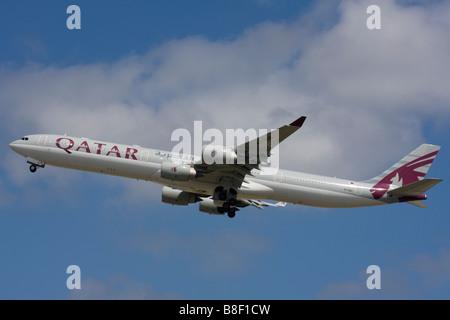 Qatar Airways Airbus A340-642 departure at London Heathrow Airport, United Kingdom - Stock Image
