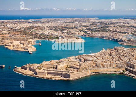 Malta aerial view. Valetta, capital city of Malta, Grand Harbour, Kalkara, Senglea and Vittoriosa towns, Fort Ricasoli and Fort Saint Elmo from above. - Stock Image