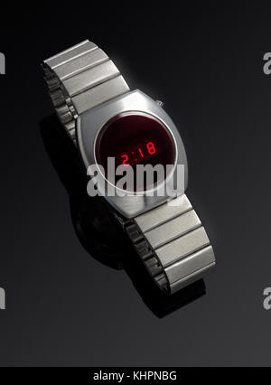Commodore Digital wrist watch and stainless steel band against a black background - Stock Image