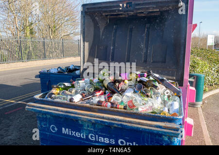 Full bottle mixed glass recycling bin - Stock Image