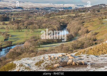 North Pennines AONB landscape, view from Whistle Crag towards Middleton-in-Teesdale and Holwick with snow covered hills in the distance - Stock Image