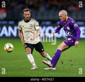 Optus Stadium, Perth, Western Australia. 13th July, 201913th July 2019, Optus Stadium, Perth, Western Australia; Pre-season friendly football, Perth Glory versus Manchester United; Neil Kilkenny of the Perth Glory passes the ball ahead of Juan Mata of Manchester United Credit: Action Plus Sports Images/Alamy Live News - Stock Image