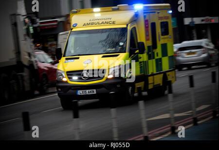 London Ambulance at speed in Whitechapel, East London. Feb 2019 - Stock Image