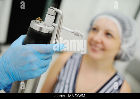 Doctor makes the patient cryotherapy procedure - Cryomassage - cold treatment - Stock Image