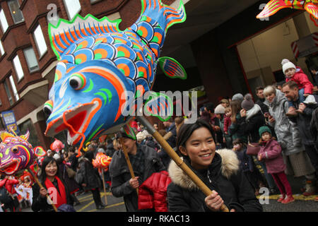 London, UK. 10th February 2019.  Performers take part in the parade on Shaftesbury Avenue as hundreds of Londoners attend the Chinese New Year Celebration in Chinatown, central London to urse in the Year of the Pig. The event was organised by the London Chinatown Chinese Association (LCCA). Photo by David Mbiyu/ Alamy Live News Credit: david mbiyu/Alamy Live News - Stock Image