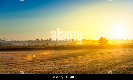 An early morning late summer sunrise at Hough on the Hill, Grantham, Lincolnshire, UK - Stock Image
