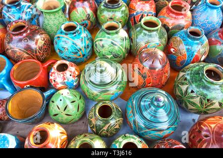 Assorted Traditional Costa Rica Porcelain Pottery and Crafts sold as Colorful Tourist Souvenirs in Manuel Antonio outdoor bazaar market - Stock Image