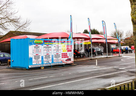 Car wash carwash business Polish workers cleaning cars for money Lincoln city UK England - Stock Image