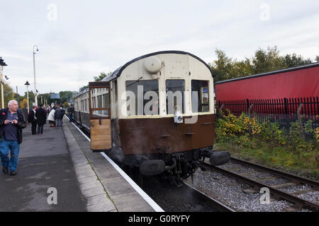 GWR autocoach at Heywood on the East Lancashire Railway pulled by former Great Western Railway pannier tank engine - Stock Image