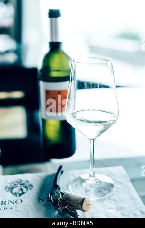 White wine in wine glass - Stock Image