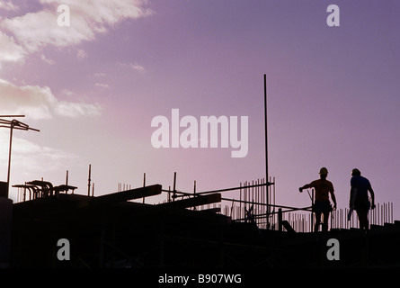 Workers on construction site - Stock Image