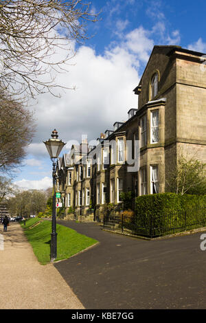 Broad Walk, Buxton, Victorian terraced townhouses face towards the adjacent Pavilion Gardens. - Stock Image