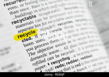 Highlighted English word 'recycle' and its definition at the dictionary. - Stock Image