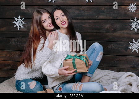 Two beautiful girls at Christmas - Stock Image