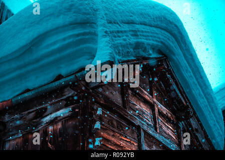 People in ski resort village covered by snow in Europe during winter. nature and architecture background - Stock Image