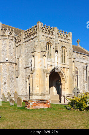 A view of the south porch of the parish Church of St Margaret in North Norfolk at Cley-next-the-Sea, Norfolk, England, United Kingdom, Europe. - Stock Image