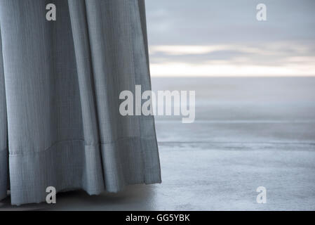 Close-up of curtains on window - Stock Image