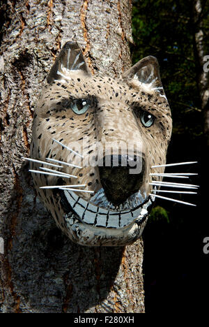 Wooden Cheshire cat sculpture Kitty Coleman Woodland Gardens Artisans' Festival Courtney , BC Canada - Stock Image