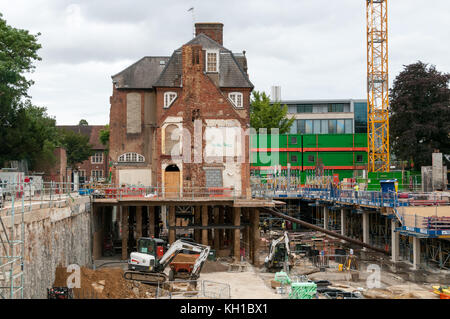 Building on pylons during reconstruction work, Oxford, United Kingdom - Stock Image