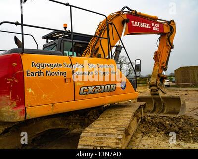 A Case CX210B JCB excavator at  a job on a farm - Stock Image