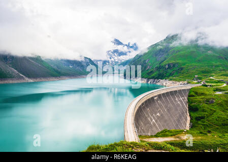 Mooserboden reservoir with hydro power station located at high mountains in Austrian Alps - Stock Image