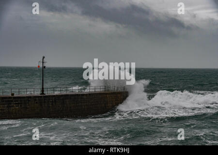 Porthleven, Cornwall, UK. 2nd Mar 2019. UK Weather. 45 mph winds starting to batter the coast of Cornwall at Porthleven this afternoon, as Storm Freya approaches. Credit: Simon Maycock/Alamy Live News - Stock Image