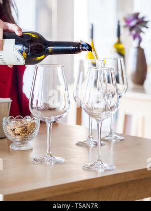 Setubal, Portugal - February 02, 2018: Woman pours wine during wine tasting at Quita do Piloto in Setubal wine region, Portugal. - Stock Image