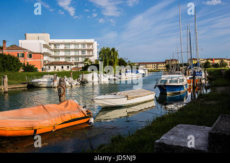 Yachts, boats and sailboats moored at the dock in Caorle - Italy in a beautiful sunny day - Stock Image