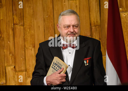 Riga, Latvia. 8th July 2019. Andris Vilks, director of Latvian National Library (LNB) with received book from President, during Reception in honour of the inauguration of President of Latvia Mr Egils Levits accompanied by First Lady of Latvia Mrs Andra Levite. Credit: Gints Ivuskans/Alamy Live News - Stock Image