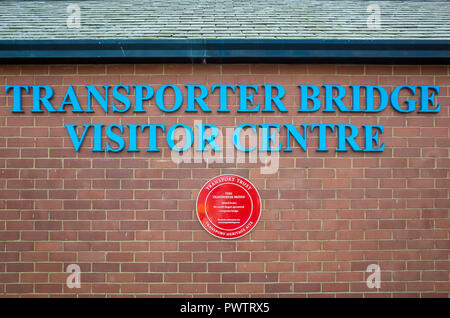 Middlesbrough Transporter Bridge Visitor Centre sign and a red Plaque for a Transport Heritage Site - Stock Image