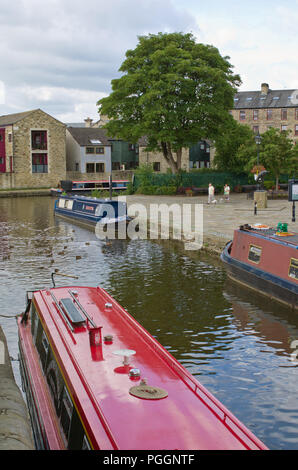 Narrow Canal Boats Leeds Liverpool Canal Skipton North Yorkshire UK - Stock Image