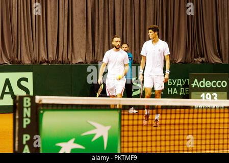 Kraljevo, Serbia. 15th September 2018. Nikola Milojevic and Danilo Petrovic of Serbia in action in the doubles match of the Davis Cup 2018 Tennis World Group Play-off Round at Sportski Center Ibar in Kraljevo, Serbia. Credit: Karunesh Johri/Alamy Live News. - Stock Image
